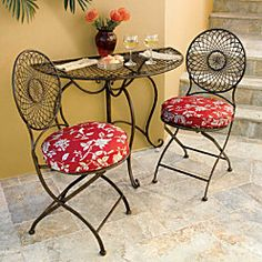 Metal Half-Round Folding Table to maximize space on a patio, front porch or balcony.  When there's not enough room for a standard table, give this charming half-round table a try. Fitting neatly against a wall, this half-round table features a lovely spiral-design top and scrolled legs; add the coordinating folding bistro chairs to create a cozy dining spot for 2. Antique brown finish that's powder-coated to resist rust and chipping.  Cushions sold separately.  $129.99-229.98