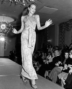 Jerry Hall walks down the runway in a wrap dress at The Pierre Hotel, 1975.