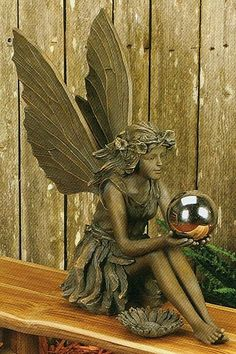 Fairy statue reminds me of my daughter's collection of fairies.