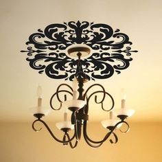 O.. I like this.  Make a plain chandelier fancy with wall decals.