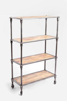 Heritage Bookshelf. Industrial metal shelf with a vintage finish. 3 wide wood shelves with a matching top shelf. Finished with wheels for easy arranging.