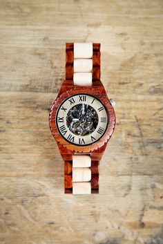 This is an amazing watch, with intricate mechanical detail with all moving parts visible through the glass face. It is our most exclusive All Wood Watch features an all Maple & Trimmed Red Sandalwood