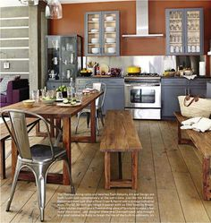 Kitchen: Gray cabinets, stainless steel, rustic kitchen table with clean lines.