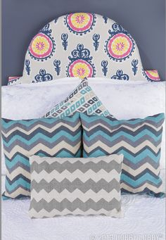 Mix and match patterns and textures of pillows and bedding for a customized look.