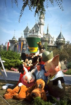 Walt Disney hanging out with some colorful characters during a 1965 photo shoot in front of Disneyland's Sleeping Beauty Castle. Source:(http://disneyparks.disney.go.com/blog/2013/08/walt-disney-and-the-disney-characters-at-disneyland-park-2)