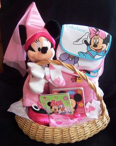 "Minnie Mouse - Large Baby Basket - Gift in deana's Garage Sale in Lindenhurst , IL for $25.99. Minnie Mouse Baby Basket Includes:         1 - Large Wicker Basket  1 - Large Plush Minnie Mouse  1 - ""It's a Girl"" Photo Pillow  1 - Baby Girl Onesie  2 - Pairs of Socks  3 - Disney Bibs  2 - Disney Books  1 - Pacifier      Very Nice."