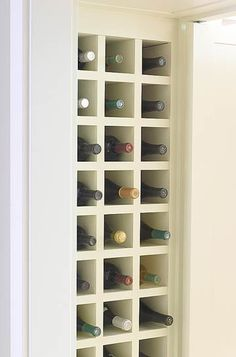 Create open faced wine closet in dining room by utilizing half of deep coat closet