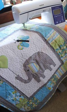 The finished Elephant Baby Quilt shown with the Brother sewing machine. Bind a baby quilt with baby's nameArts And Crafts House Style Refferal: a baby shower can be an extremely fun and rewarding experience, however it is importa Quilt Baby, Owl Baby Quilts, Quilted Baby Blanket, Girls Quilts, Baby Quilts For Boys, Elephant Baby Blanket, Elephant Quilts Pattern, Free Baby Quilt Patterns, Elephant Applique