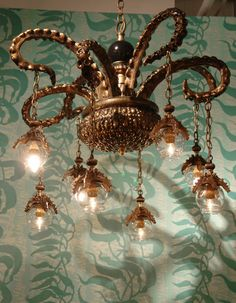 An assortment of Adam Wallacavage's handcrafted octopus chandeliers may be found on his website or at the Jonathan LeVine Gallery website . Steampunk House, Steampunk Design, Chandelier Lighting, Chandeliers, Nautical Chandelier, Lighting Store, Modern Chandelier, Tentacle, Cthulhu