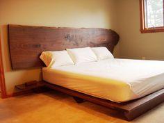 giant walnut slab headboard and platform bed