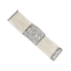 Platinum, Pearl and Diamond Bracelet The multi-strand bracelet composed of 626 pearls, the central panel and clasp set with old European-cut diamonds weighing approximately 4.20 carats, length 6¾ inches; the platinum elements circa 1915.