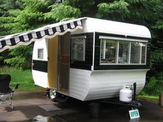Vintage Oasis camper. Love the crisp black and white paint job and matching awning on this one! So cute :)