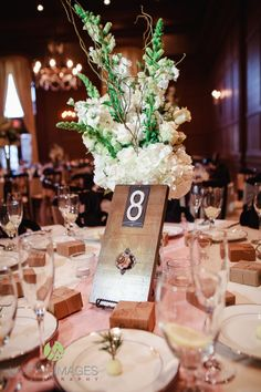 Wooden table numbers, detailed with a pink handle | villasiena.cc
