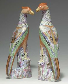 A LARGE PAIR OF SAMSON PORCELAIN PHEASANTS  LATE 19TH CENTURY  Formed in mirror image perched on colorful rockwork, each with gilt-enriched iron-red head and shaded iron-red breasts, his wings folded showing plumage picked out in colorful famille rose enamels  18 7/8 in. (48 cm.) high (2)