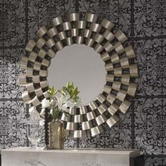 This beautiful Clinks round mirror exudes elegance and class. The wonderful mirror offers a distinctive design that would create the wow factor in any home environment. The round design of this mirror offers a softer look than the traditional rectangular mirror creating an outstanding feature in your living space. The