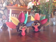 DIY turkey thanksgiving craft with pinecones. (My son is convinced they are owls!) On Thanksgiving I'll try to talk our guests into jotting down their blessings on the feathers