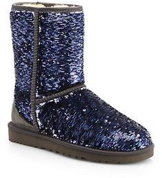 "UGG Australia Classic Two-Tone Short Sparkle Boots, Add sparkle to your step with these ultra-warm tonal boots, lined with plush shearling for superior comfort and fit.;Rubber platform, 3⁄4"" (20mm);Shaft, 71⁄2"";Leg circumference, 13"";Sequin-coated upper with satin trim;Sequins are two-tone and will reveal silver or blue depending on how they are brushed;Pull-on style;Shearling lining;Rubber sole;Padded insole;Imported"
