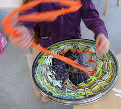 Weaving with carrier bags on a bike wheel