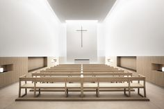 Interior of the Benéfico Social Padre Rubinos Institution in Spain by Elsa Urquijo Architects. A beautiful combination of wood and plaster.