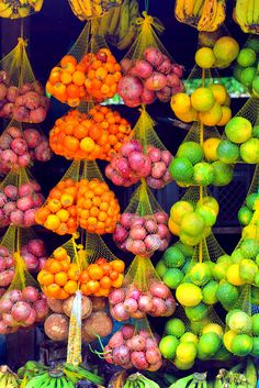 Gorgeous photograph of Fruit hanging in the market at Tabatinga on the Amazon River in Brazil #food #photography #fruit