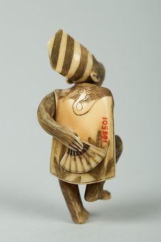 Netsuke of Monkey Wearing a Tall Cap and Carrying a Fan | Japan | The Met