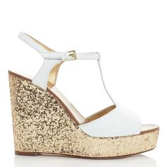 kate spade | day  This is a glittery new take on the comfy classic- the wedge sandal. It can go from the beach to night without breaking stride, and with the platform, these would be much easier to walk in than other heeled sandals. I love how the bright white contrasts with the dazzlingly shimmery gold heel!