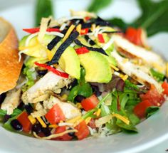 Southwestern Salad....Dancing Fox, Lodi, CA  ...a very yummy salad!      Fresh citrus marinated black beans and corn, crispy greens, tomato, avocado, chipotle ranch, topped with cheddar & tri color corn chips