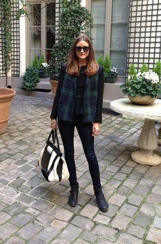 Olivia Palermo in a plaid vest + black blouse + black skinny jeans + black moto boots