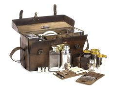 Our favorite is this leather-cased four-person picnic set by W Thornhill & Co. of New Bond Street, London, made circa 1913.    Estimated at $4,000 – $5,000, it comes fitted with a silver-plated cocktail shaker, two glass spirits flasks with silver caps, a leather-cased set of drinking beakers, two nickel-plated sandwich tins, gilt-edged enamel plates and cutlery, measuring tots and a corkscrew.