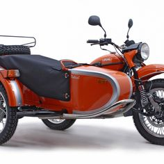 2012 Orange Ural Patrol  Would be fun to drive the pup around