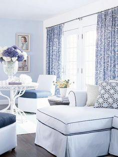 lovely sunroom, the pale blue accent wall shimmers in the morning light.