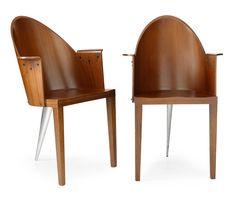 "PHILIPPE STARCK, ""Royalton"", armchairs, Aleph, France, designed in 1988, mahogany veneer, one leg aluminum."