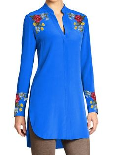 Simply elegant! This top kurti tunic has an elegant touch. Delicate yet colorful floral pattern is embroidered on the shoulder as well as along the full sleeve