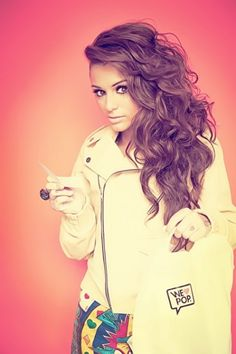 Long gorgeous curly hair. And I really like that jacket.