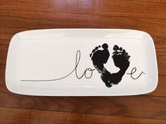 DIY a baby footprint love plate for grandparents this year. A sweet craft keepsake gift.