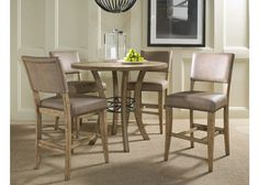 Hillsdale's Charleston collection beautifully combines a rustic desert tan wood finish with a dark grey metal and offers a multitude of choices to create the perfect counter height dining group for yo