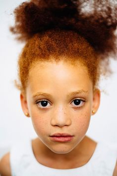 Mixed girl with red hair and very dark eyes/ the MC1R series