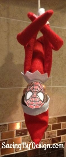 Spidey Elf! Find this and many other ideas in 30 Days of Elfing Around! #ElfOnTheShelf #ElfIdeas #ElfPoses
