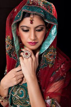 Image from http://cf.ltkcdn.net/weddings/images/slide/150084-566x848r1-Indian-bride.jpg.