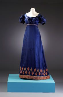 Long dark blue dress with patterned hem line (Regency/Jane Austen Fashion) Number: BATMC I.09.1255 Material(s): silk Technique(s): woven (satin) and embroidery (chain s...