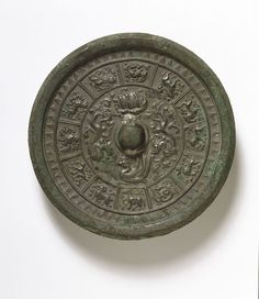 Bronze mirror decorated with the Animals of the Four Directions (dragon, tiger, tortoise and pheonix) and the Twelve Zodiac Animals, Chinese, Tang dynasty, 7th-8th century; Met, China, mirrors
