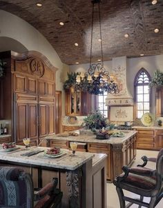"OMG ~ What a magnificent kitchen with Old World charm!  Love the brick barrel ceiling, the windows, the massive island, and the beautiful chandelier.  Would love to have a double refrigerator like this one!  From the Facebook community ""Brambleberry Cottage""."