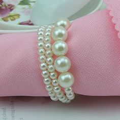 Product description Material: faux Pearl napkin rings Used for: weddings, parties, gifts, give your wedding party does not feel thesame way, a pleasant mood. 100% brand new high quality Material: faux Pearl napkin rings Used for: weddings, parties, gifts, give your wedding party does not feel thesame way, a pleasant mood.