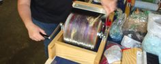 Adding fluff onto the Mad Batt'r drum carder at Strauch Fiber Equipment