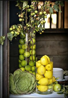 Not so sure about the lemons and limes, but I like the branches full of fruit. Seems like it fits with the theme and would be available that time of year.