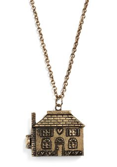 This house opens and then you see furniture inside, I bought two of these Necklaces, one for my mother for mothers-day and one for myself.(We both love dollshouses)