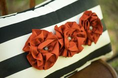 Lola pillow.  Black and white silk stripe with handmade silk paprika flowers.