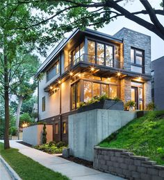 Lake Calhoun Modern Organic - Fully integrated into its elevated home site, this modern residence offers a unique combination of privacy from adjacent homes. The home's graceful contemporary exterior features natural stone, corten steel, wood and glass—all in perfect alignment with the site. The design goal was to take full advantage of the views of Lake Calhoun that sits within the city of Minneapolis by providing the homeowners with expansive walls of Integrity® Wood-Ultrex® Windows. With…