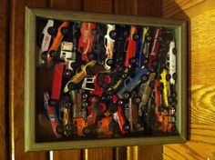 Shadow box with old hot wheels