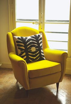 one yellow chair in the living room